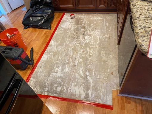 Before repairs - water damaged floor
